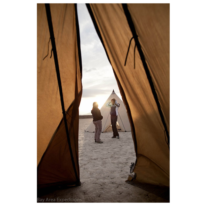 12 Man Tipi Interior Photo onto the outside with people and the sunset visible