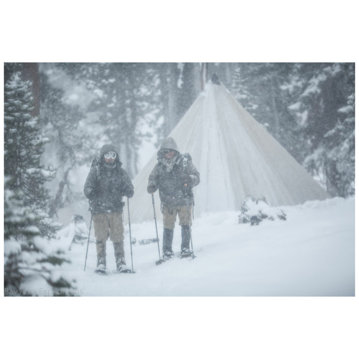 12 Man Tipi in the Winter with Two People Skiing