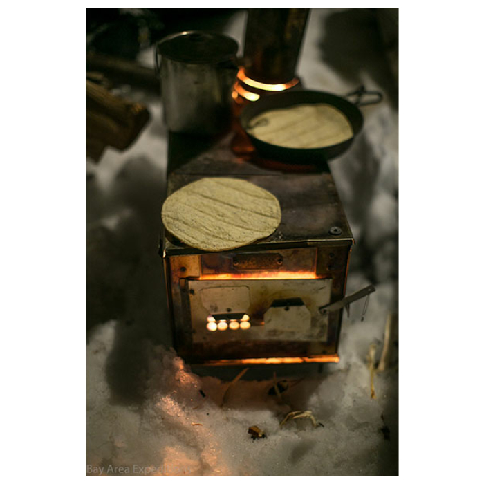 12 Man Tipi stove photo from above heating up tortillas