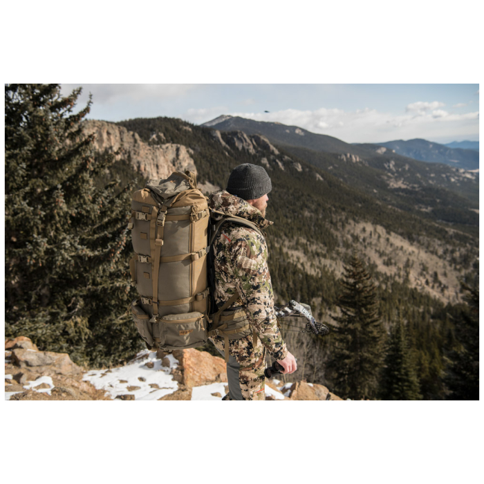 Cavern (6,500ci - 106L Bag only) Diagonal Back Photo of Ranger Green Color While Being Worn by Hunter in Hunter Trip